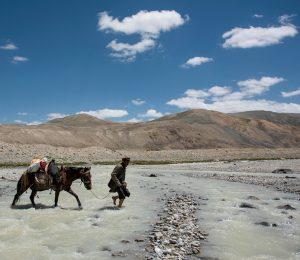 Crossing a river in the Wakhan Corridor, Afghanistan