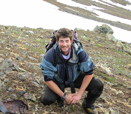 Expedition leader Phil De Beger smiles contently all geared up for his trek in Kurdistan