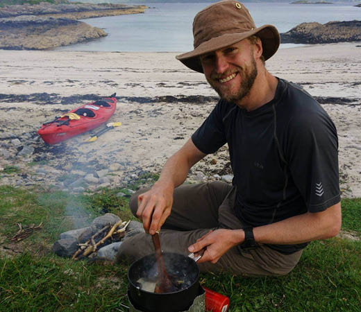 Expedition leader Lachlan Bucknall preparing dinner