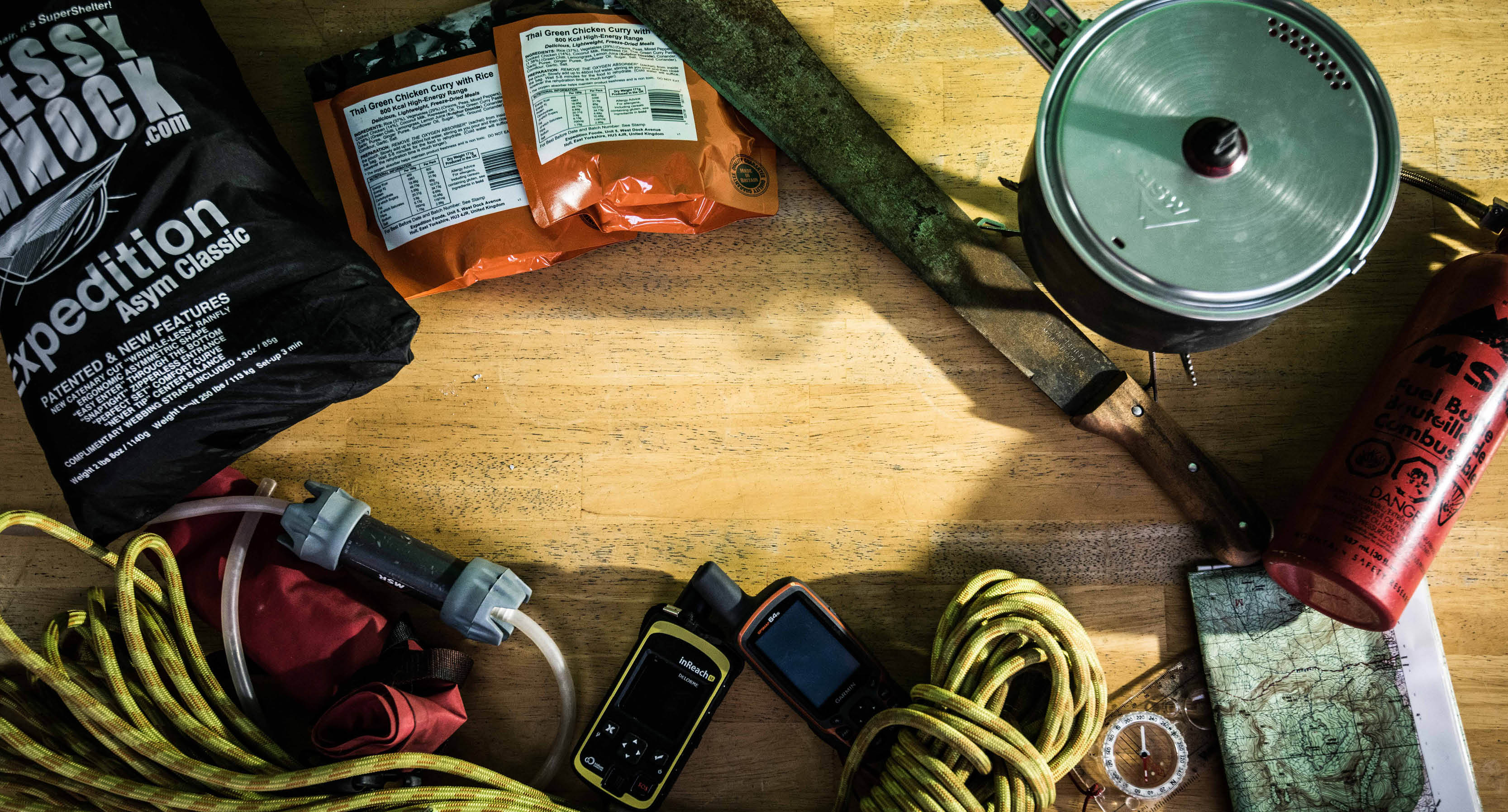 Handbook, map, rope, kit, fuel bottle, expedition food, comms