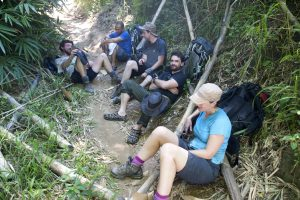 Levison Wood and expedition team relax on a path in Madagascar