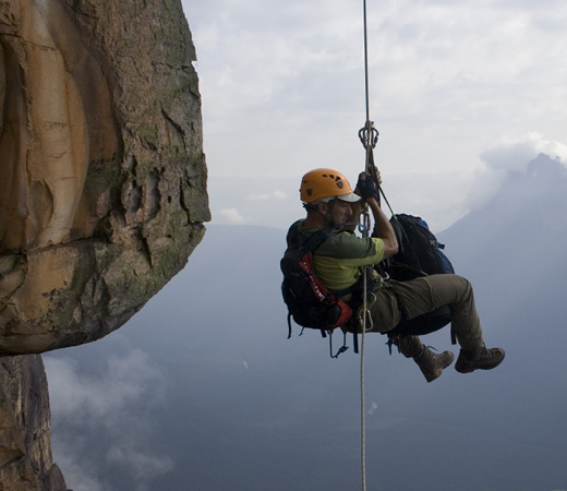 Abseiler in mid air, Venezuela expedition to Abseil Angel Falls world's highest waterfalls