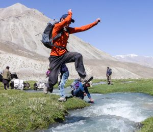 Man jumping river Afghanistan