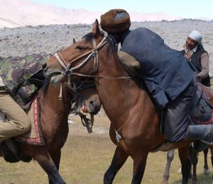 Horses men playing buzkashi, Afghanistan