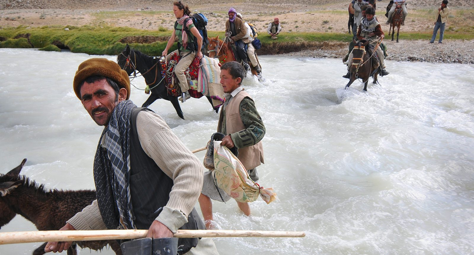 River crossing with Afghanistan local's deep in the Wakhan Corridor within the Pamir Mountains