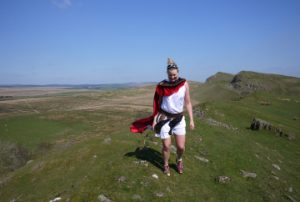 Anna McNuff jogs along Hadrians Walls ...Dressed as a gladiator