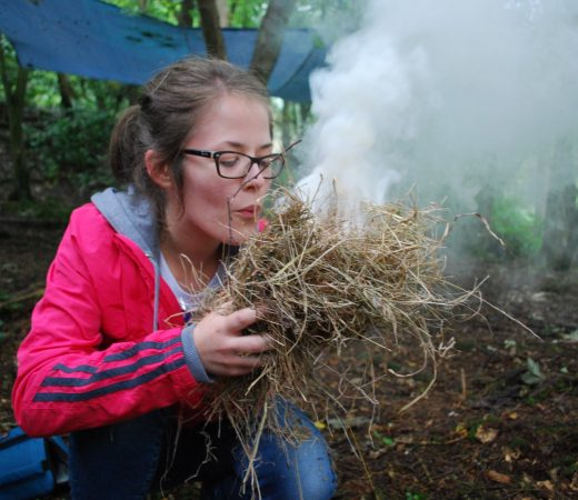 Basecamp Festival image, girl blowing out fire