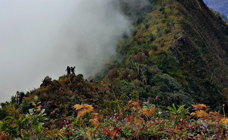 Burma ridgeline trek with cloud engulfing the mountain