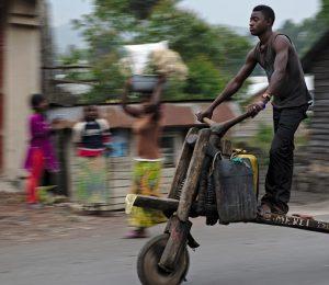 DRC Virunga expedition, man on scooter