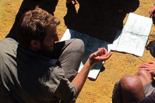 Madagascar team planning with a map