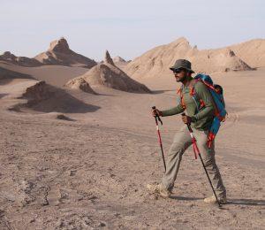 Iran Lut Desert man trekking in the kaluts