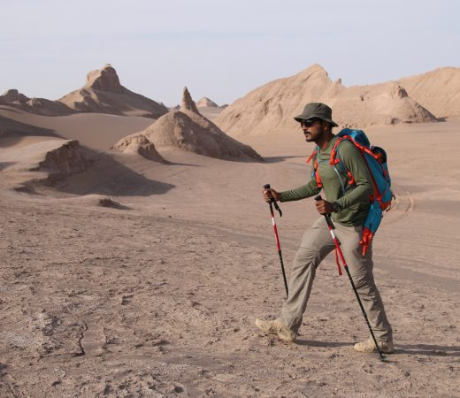 Iran Lut Desert man trekking in the kaluts