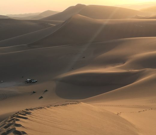 Iran Lut Desert sunset dunes and cars