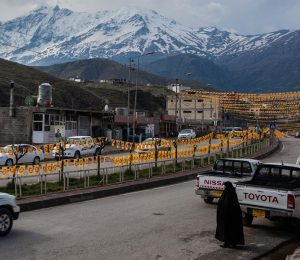 Iraqi Kurdistan Grid Square image hill town view woman car mountains