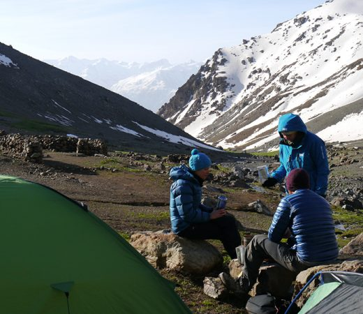 Iraqi Kurdistan teammates near tents on mountain side in Iraqi Kurdistan