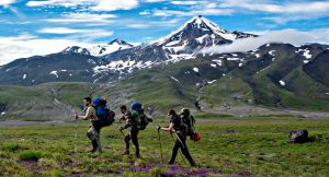 Trekkers making their way on their expedition with secret compass in Kamchatka