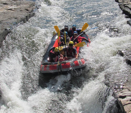Secret Compass team white water rafting down the rivers of Papua New Guinea
