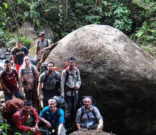Team photo next to one of the ancient petroglyphs in the Darien Gap jungle