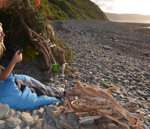 Phoebe Smith, travel writer rests on a beach