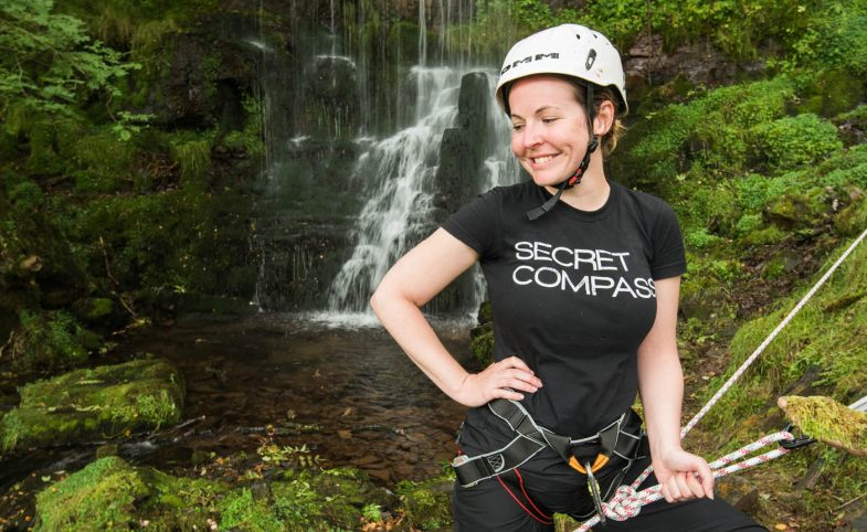 Rhiannon in the Brecons Beacons abseiling down the waterfall
