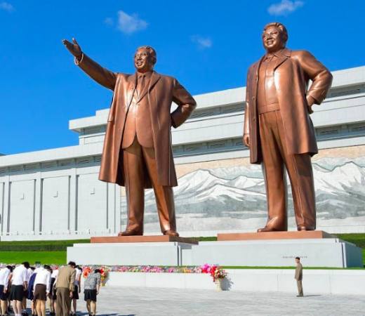 The Mansu Hill Grand Monument stands tall as North Korean civilians show their respect