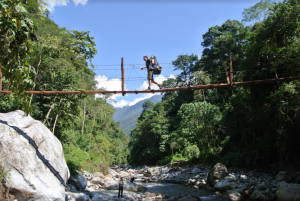 Bridge crossing during expedition in Burma