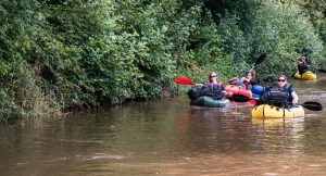 Team in the Brecon Beacons packrafting