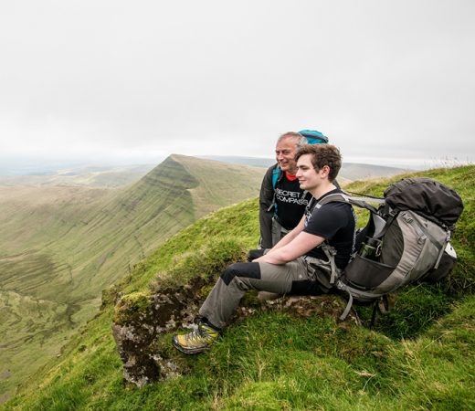 Secret Compass adventure academy trekkers take a break on the Brecon Beacons