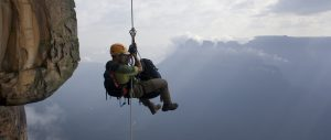 Venezuela, man abseiling Angel Falls