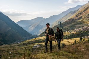 Levison Wood and his guide Binod walk in the hills of Nepal near
