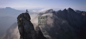 Banff Film Festival image of bike on mountain for Secret Compass expeditions site