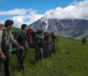 Taking a breather to relax and take in the scenery during a challenging multi-day trekking expedition on Russia's Kamchatka Peninsula