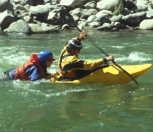 Expedition team members practice white water rafting rescue training in Papua New Guinea