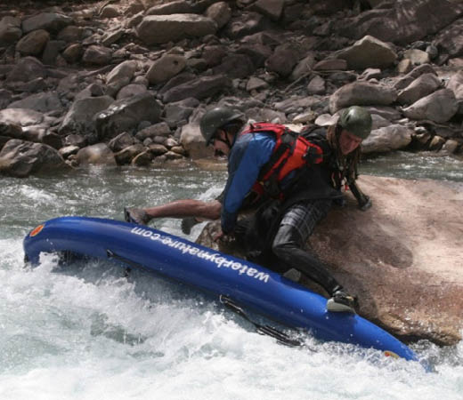 Team members prepare to continue white water rafting down the rivers in Papua new Guinea
