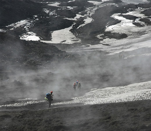 Trekking back down from the summit through drifting volcanic smoke