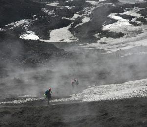 Trekking back down from the summit through drifting volcanic smoke