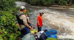 Team members heading down stream, Gabon