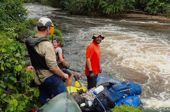 Team members heading down stream, Gabon