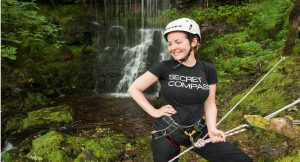 Abseiling down a water fall on UK adventure academy expedition in Wales