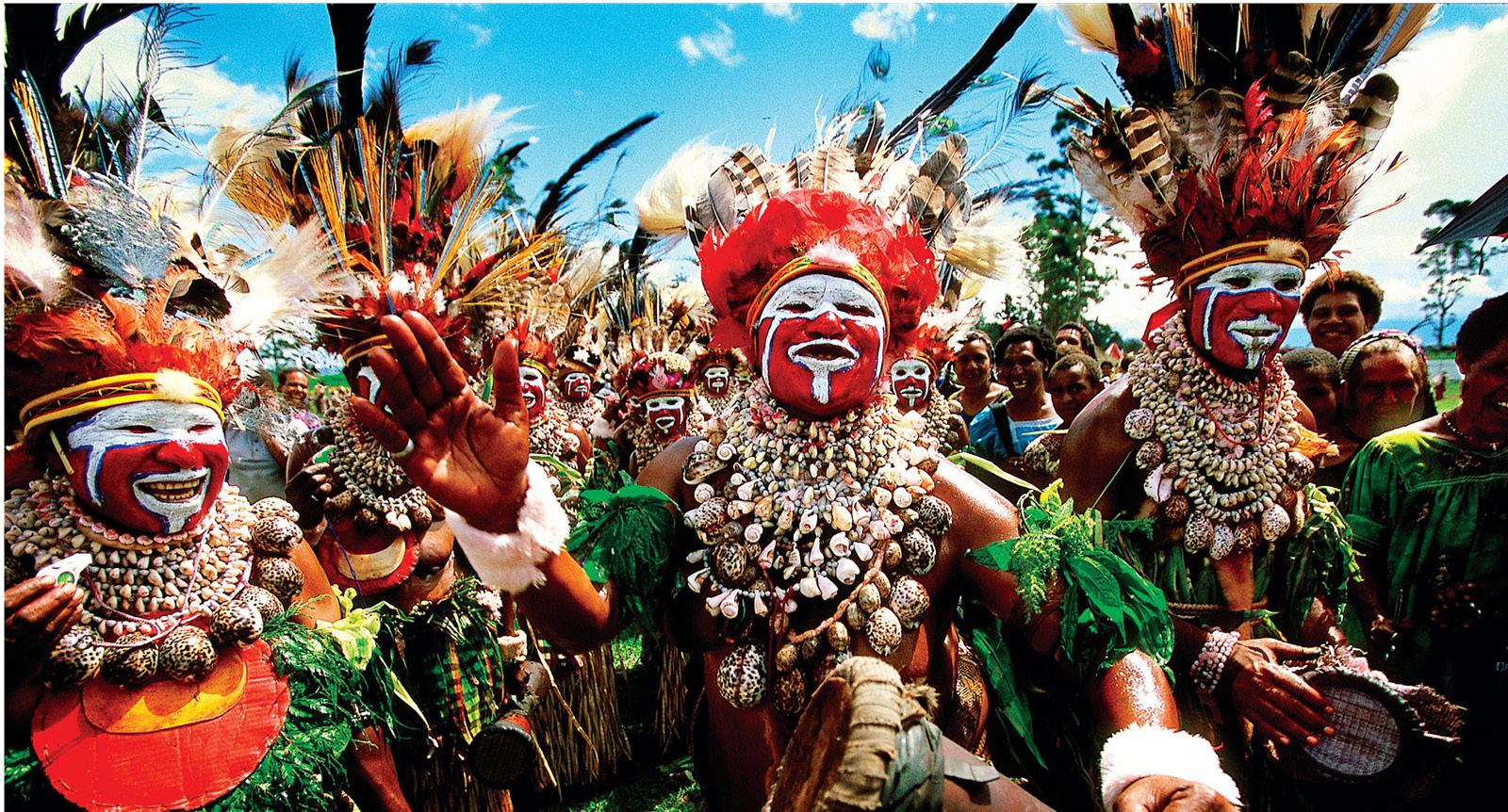 Papua New Guinea traditional tribes men carrying out dancing ritual