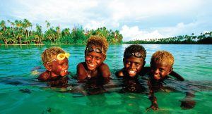 Papua New Guinea, local children play in the water
