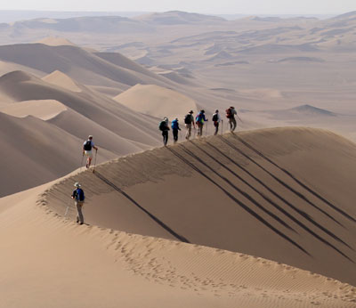 Trekking across the high dunes of the Lut desert, Iran