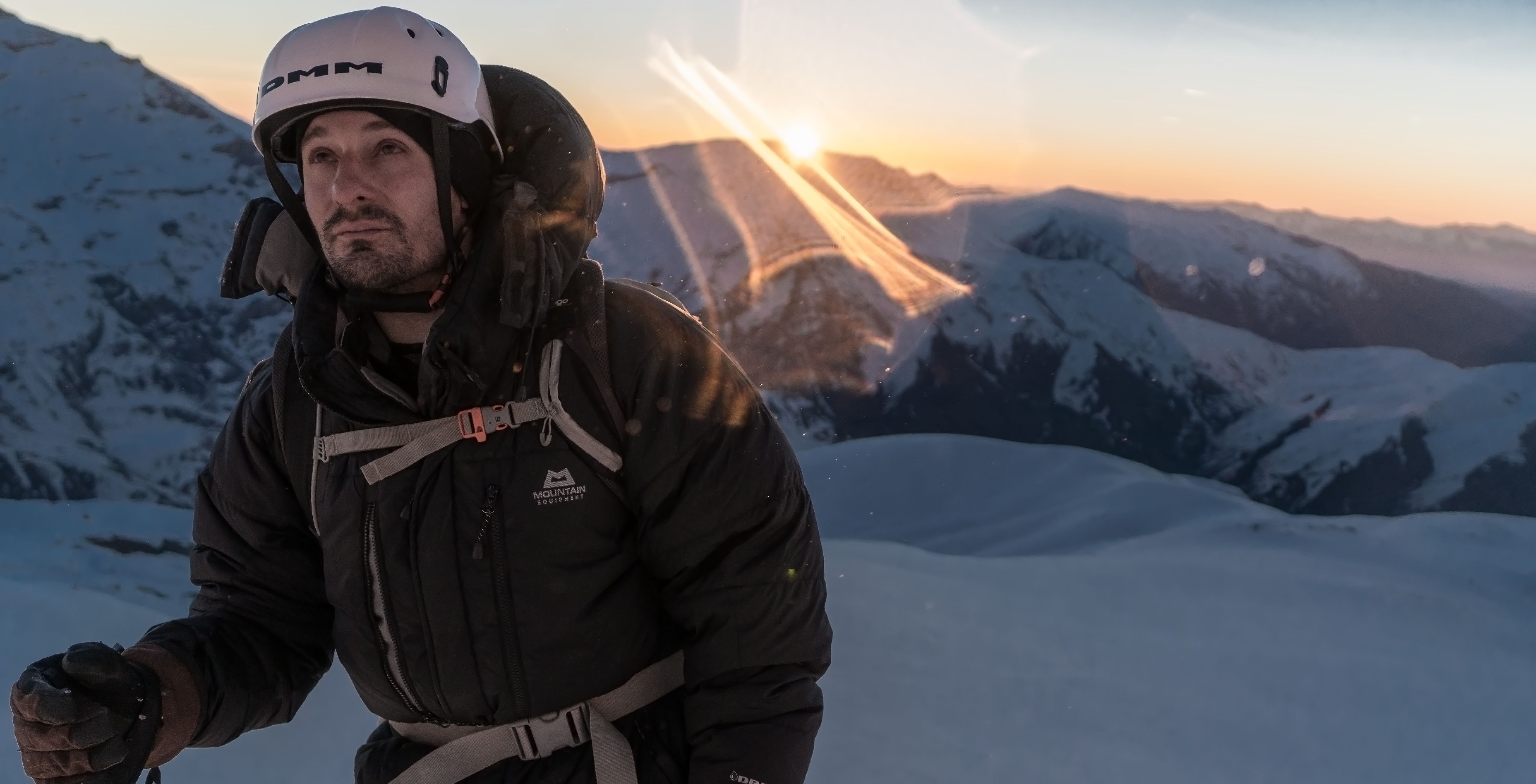 The day's first rays of light make it over the mountain tops to grace the backs of the expedition team members ascending to the summit of Mt. Halgurd