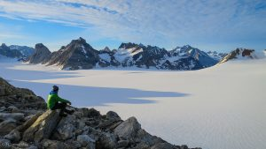 A reflective moment up high in Greenland's Schweizerland Alps.