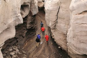 The team weave their way through old Lava canyons, carved out by previous explosions