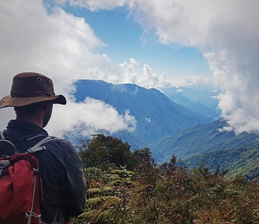 Expedition leader Lachlan Bucknall with a viewpoint over Burma's Nagaland