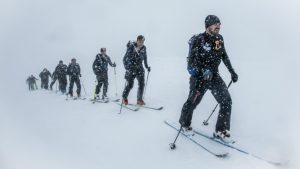 Secret Compass Managing Director Tom Bodkin leads his team through a whiteout to reach the daily elevation target on their way to scaling 8,848m © Adventure In Focus
