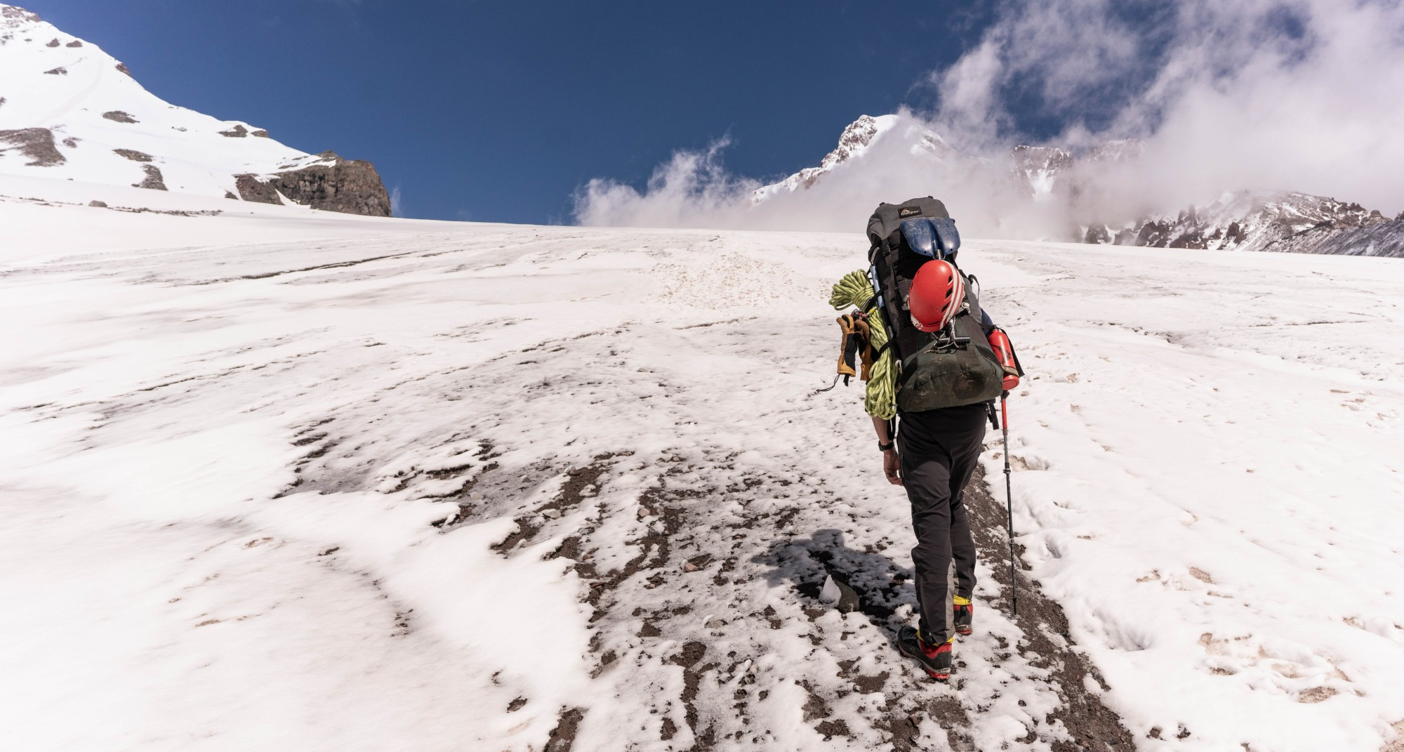 Secret Compass expedition leader Matt Barratt hikes his way towards the summit of Georgia's Mount Kazbek