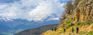 Secret Compass team trekking on the lower slopes towards the summit of Iraqi Kurdistan's Mount Halgurd © Tom Kontson