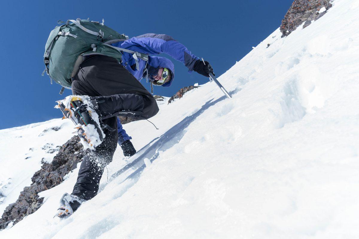 SC expedition leader Lachlan Bucknall kicks steps on Mount Halgurd in Iraqi Kurdistan